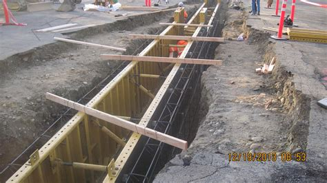Excavating the shallow guide wall to prepare for building