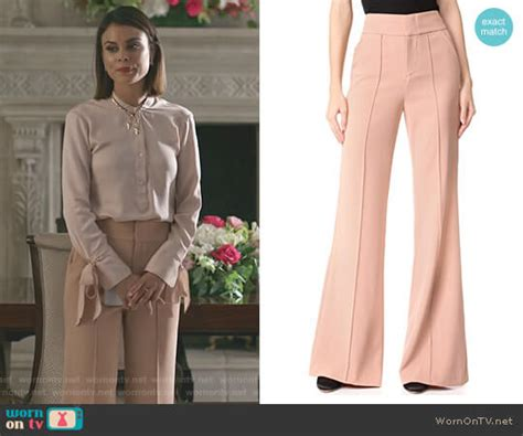 WornOnTV: Cristal's pink cable knit sweater and wide-leg